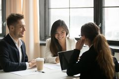 Female CEO talking with colleagues in office royalty free stock photos
