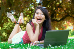 Laughing asian girl at the park stock images