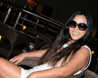 Laughing Asian woman in sunglasses Stock Photo