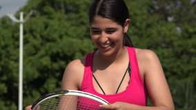 Laughing Athletic Female Teenage Tennis Player. A young female hispanic teen stock video footage