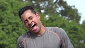 Laughing Athletic Hispanic Adult Male. A handsome adult hispanic man stock footage
