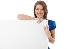 Laughing attractive woman with blank sheet. In studio, copyspace Stock Photo