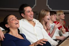 Laughing audience at the movies stock photography