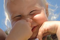 Laughing baby. Happy face of laughing baby Stock Images