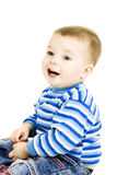 Laughing baby. Boy is sitting on the floor isolated on white Stock Photos