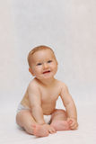 Laughing Baby. Portrait of naked laughing baby Stock Photography