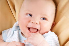 Laughing baby Stock Images