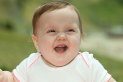 Laughing baby. Portrait of a cute baby girl laughing Royalty Free Stock Image