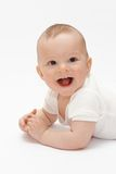 Laughing baby. Lying on the floor royalty free stock photos