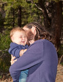Laughing baby boy. Baby boy laughing when his dad cuddles him Stock Photo