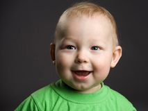 Laughing baby boy. Portrait of laughing baby boy with studio background Royalty Free Stock Image