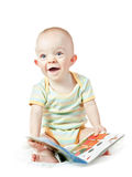 Laughing baby boy with book Stock Photography