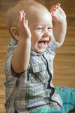 The laughing baby boy. Emotional portrait of the kid in game. On a photo the boy at the age of nine months is represented, he likes to play much with adults Stock Image