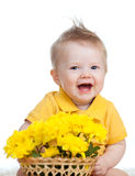 Laughing baby boy with flowers in basket Stock Photo