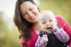 Laughing Baby Boy Has Fun With Mommy Outdoors Stock Photography
