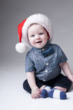 Laughing baby boy in santa hat. Royalty Free Stock Photography