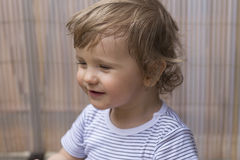 Laughing baby boy. Sitting on the balcony Stock Image