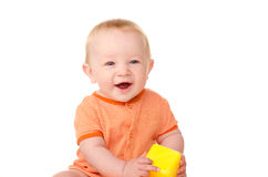 Laughing baby boy with toy brick Stock Photos