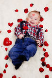 Laughing baby boy with valentines heart Royalty Free Stock Photos
