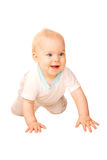 Laughing baby crawling away. stock image