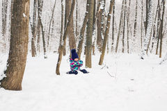 Laughing baby girl lying in the snow Royalty Free Stock Photography