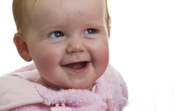 Laughing baby girl in pink Royalty Free Stock Images