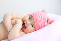 Laughing baby girl in pink hat Royalty Free Stock Images