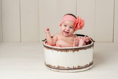 Laughing Baby Girl in Wooden Bucket Royalty Free Stock Images