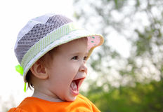 Laughing baby in hat outdoor Royalty Free Stock Photo