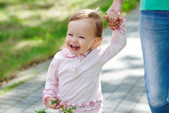 Laughing baby holding mom's hand stock photos
