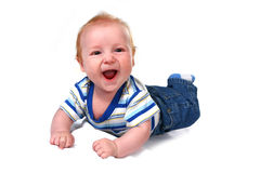 Laughing Baby Infant Boy Lying on His Tummy Stock Images
