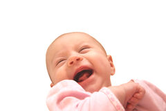 Laughing baby isolated on white. Laughing baby girl in pink dress isolated on white Stock Image