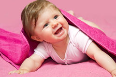 Laughing baby looking at camera Royalty Free Stock Photos