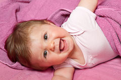 Laughing baby looking at camera Royalty Free Stock Photo