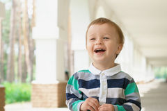 Laughing baby outdoors with copy space Royalty Free Stock Photos