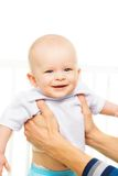Laughing baby in parents hands Stock Photography