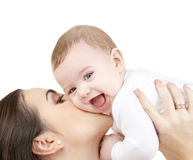 Laughing baby playing with mother stock image