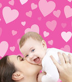 Laughing baby playing with mother Royalty Free Stock Images