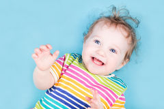 Laughing baby in a striped shirt Royalty Free Stock Photo