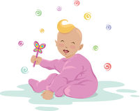 Laughing baby with a toy Royalty Free Stock Image
