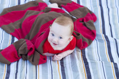 Laughing baby under sweater Royalty Free Stock Photos