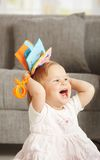 Laughing babygirl with toy. At home Stock Photos