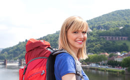 Laughing backpacker with blonde hair in Europe Royalty Free Stock Image