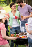 Laughing at the barbecue party Stock Photo
