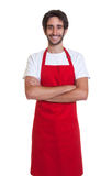 Laughing barkeeper with crossed arms Royalty Free Stock Image