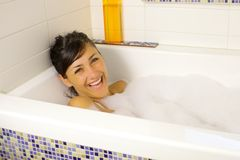 Laughing in bath tub full of foamF Royalty Free Stock Image