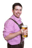 Laughing bavarian guy with leather pants and a glass of beer Stock Images