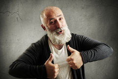 Laughing bearded man showing thumbs up Royalty Free Stock Photography