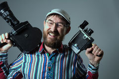 Laughing bearded man two old retro film camera Royalty Free Stock Images
