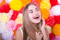 Laughing beautiful blond woman on a bright background Royalty Free Stock Photography